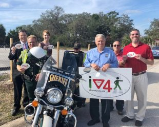 News 13's Ryan Harper, OCSO deputy, BFF's Amanda Day, Commissioner Bryan Nelson, BFF data collector Tony Calabro, City of Kissimmee planner and BFFer Randy Schrader
